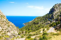 Island scenery, seascape of Mallorca Spain. Idyllic coastline of Majorca, Mediterranean Sea on sunny day. Turquoise water and green hills of Serra de Royalty Free Stock Image