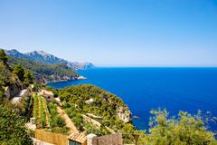 Island scenery, seascape of Mallorca Spain. Idyllic coastline of Majorca, Mediterranean Sea on sunny day. Turquoise water and green hills of Serra de Royalty Free Stock Photography