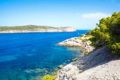 Island scenery, seascape of Mallorca Spain. Idyllic coastline of Majorca, Mediterranean Sea on sunny day. Turquoise water and green hills of Serra de Royalty Free Stock Photos