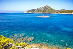 Island scenery, seascape of Mallorca Spain. Idyllic coastline of Majorca, Mediterranean Sea on sunny day. Turquoise water and green hills of Serra de Stock Images