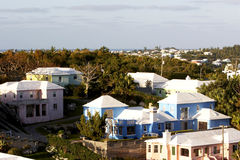 Island scenic colorful homes. Overlooking Bermuda. Colorful houses with white roof tops stock image