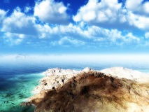 Island By The Sea. A rocky island by the sea with cloud background Stock Photo