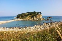 Island in sea bay, Primorye, Russia Stock Photos