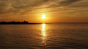 Island in sea at orange sunset Royalty Free Stock Photo