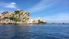 Island on the sea in a sunny day with blue sky stock video footage