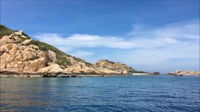 Island on the sea in a sunny day with blue sky stock footage