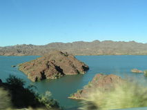 Island Set in Mountain Lake. Small island set in deep blue waters of lake off of Colorado River Stock Photography