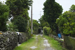 Island settlement road. Road of residential area not paved on remote island of Okinawa Royalty Free Stock Photos