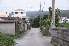 Island settlement road. Road of residential area not paved on remote island of Okinawa Stock Photo