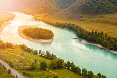 Island in the shape of a half heart. Turquoise Katun river. Altai landscapes Stock Image