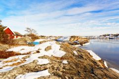 Island shelf covered with snow, near summer cottage Royalty Free Stock Photography