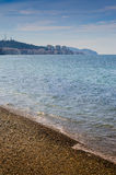 Island Shoreline With Blue Sea And Afternoon Sky Royalty Free Stock Photography