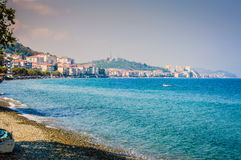 Island Shoreline With Blue Sea And Sky Stock Photo