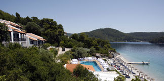 Island of Skopelos hotel. General view of hotel near beach with swimming pool and decorated tables for wedding in Skopelos Island Royalty Free Stock Photos
