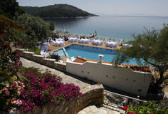 Island of Skopelos hotel wedding tables. General view of restaurant with swimming pool and decorated tables for wedding in Skopelos Island, Greece Stock Photos