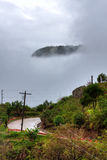 Island in the sky. Philippine hillside covered in clouds Stock Photography