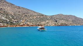Island of spinalonga in crete. To the island of spinalonga, crete in a beautiful boat royalty free stock photography