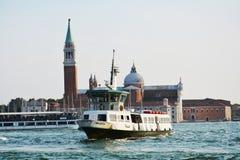 Island of St. Giorgio Maggiore and ferry-boat, Venice stock photography