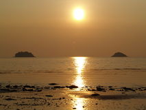 Island in the sun. The sun sets in between two island just of Koh Chang, Thailand Stock Photos
