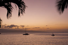 Island sunset. Sunset from Maui with boats on the water Stock Image