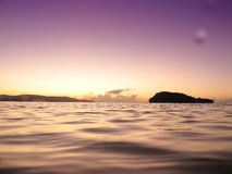 Island with sunset. A tropical island view with ocean Royalty Free Stock Photography