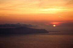 Island Sunset. Misty Sunset over Greek Islands royalty free stock image
