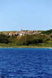 Island Susak near Mali Losinj at adriatic sea in Croatia. Sea view on village Susak at adriatic sea near island Losinj with a blue sky in summer day Royalty Free Stock Photo