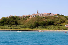 Island Susak near Mali Losinj at adriatic sea in Croatia. Sea view on village Susak at adriatic sea near island Losinj with a blue sky in summer day Stock Photography