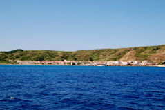 Island Susak near Mali Losinj at adriatic sea in Croatia. Sea view on village Susak at adriatic sea near island Losinj with a blue sky in summer day Royalty Free Stock Photos