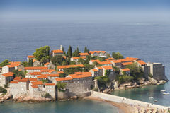 Island of Sveti Stefan. At the Adriatic coast in Montenegro. It's red roofed old houses were used by pirates, now as a hotel resort Stock Images