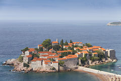 Island of Sveti Stefan. At the Adriatic coast in Montenegro. It's red roofed old houses were used by pirates, now as a hotel resort Royalty Free Stock Photography