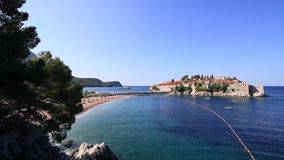 Island of Sveti Stefan, close-up of the island in the afternoon. stock video