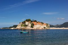 The island of Sveti Stefan. Boat on the foreground royalty free stock photos