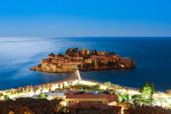 The island of Sveti Stefan at night. Montenegro, the Adriatic Se stock images