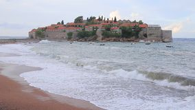 The Island of Sveti Stefan. Storm on the beach. Montenegro, the. Adriatic Sea, the Balkans stock footage