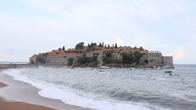 The Island of Sveti Stefan. Storm on the beach. Montenegro, the stock footage