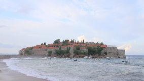 The Island of Sveti Stefan. Storm on the beach. Montenegro, the stock video