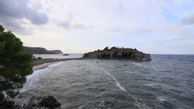 The Island of Sveti Stefan. Storm on the beach. Montenegro, the stock video footage