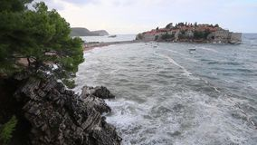 The Island of Sveti Stefan. Storm on the beach. Montenegro, the. Adriatic Sea, the Balkans stock video