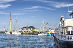 Boats in Oudeschild harbour. Island of Texel, The Netherlands, July 21, 2018: Several boats and yachts in the harbour of Oudeschild on a sunny summer day royalty free stock photos