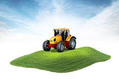 Island with tractor floating in the air on sky background. 3d rendered illustration of an island with tactor floating in the air on sky background Royalty Free Stock Photography