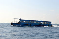 An island transfer ferry. Boats which are cheap to travel in but are very slow and more time consuming Stock Photos