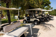 Island transport. Line up of golf cart buggies used for Island transport Stock Images