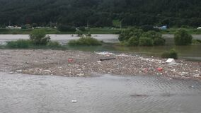 Island of trash and debris in flooded river