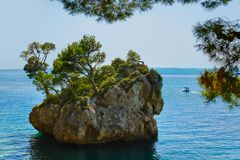 Island and trees in Brela, Croatia Royalty Free Stock Photography