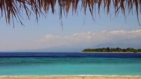 Island in turquoise sea loop Stock Image