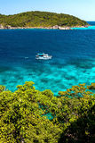 The island in the turquoise sea. white ship. Royalty Free Stock Photos