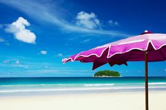 Island and umbrella Royalty Free Stock Images