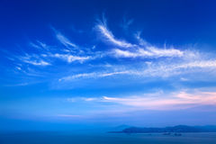 Island under clouds Royalty Free Stock Images