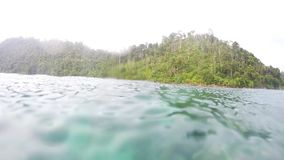 Island Underwater. Island distance view underwater during rain stock video footage